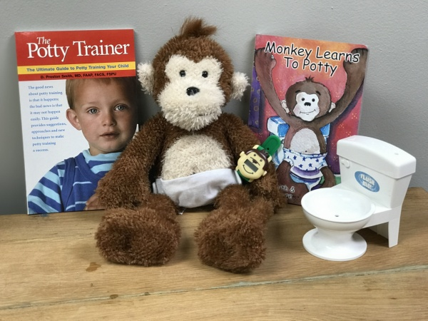 Potty Monkey potty training system with interactive monkey, flushing-sounds toilet, books for adults and child, and Potty Monkey Watch